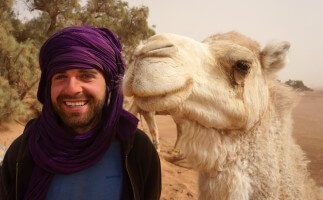 Photographer Jan Miřacký with camel in Sahara, Morocco