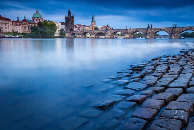 Charles bridge in historical Prague after sunset