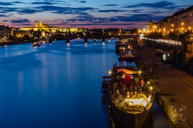Boats at Vltava riverside at night
