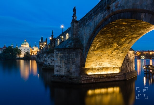 Illuminated arch of Charles bridge at night