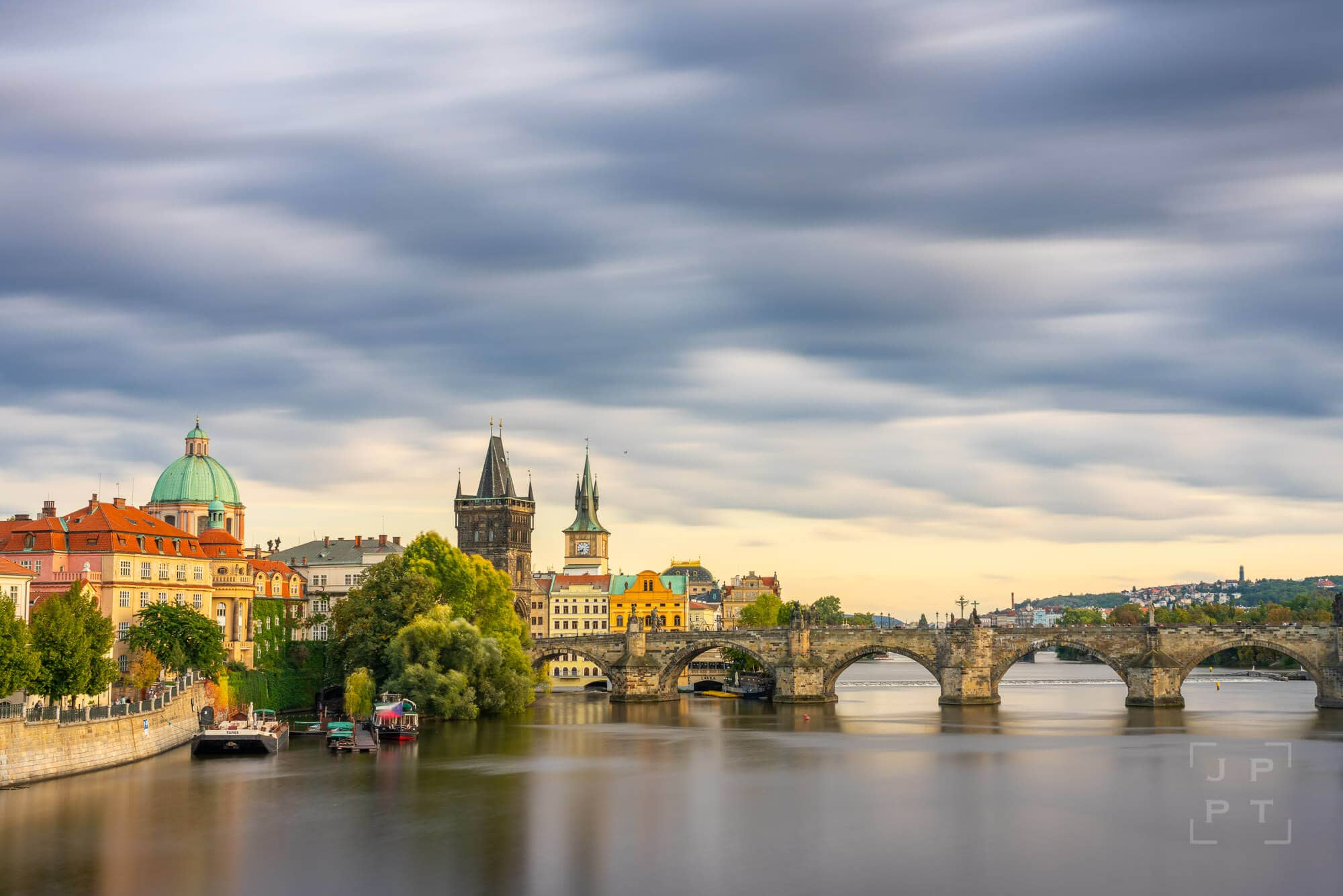 Charles bridge with moving clouds, Prague