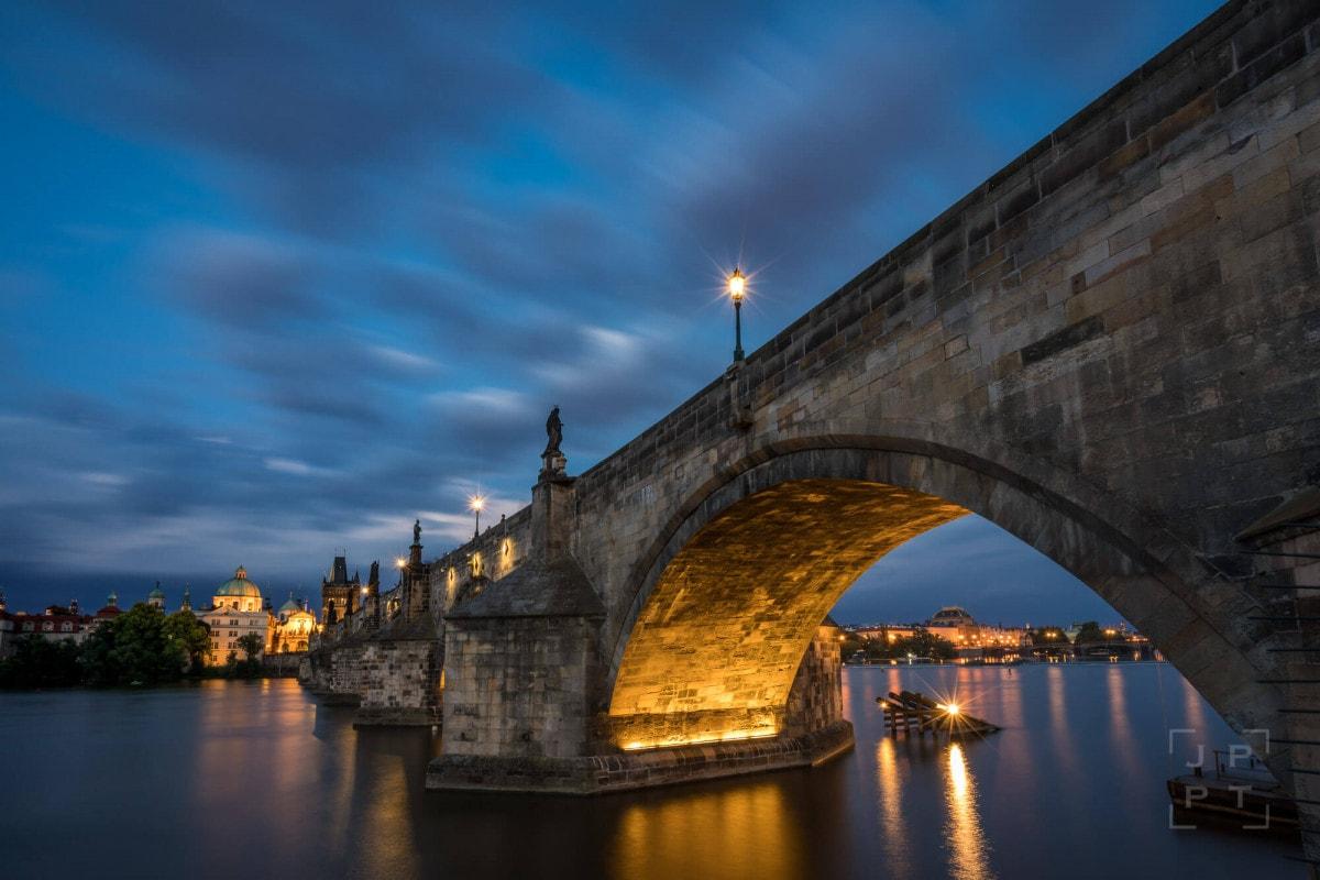 Illuminated arch of Charles bridge, Prague
